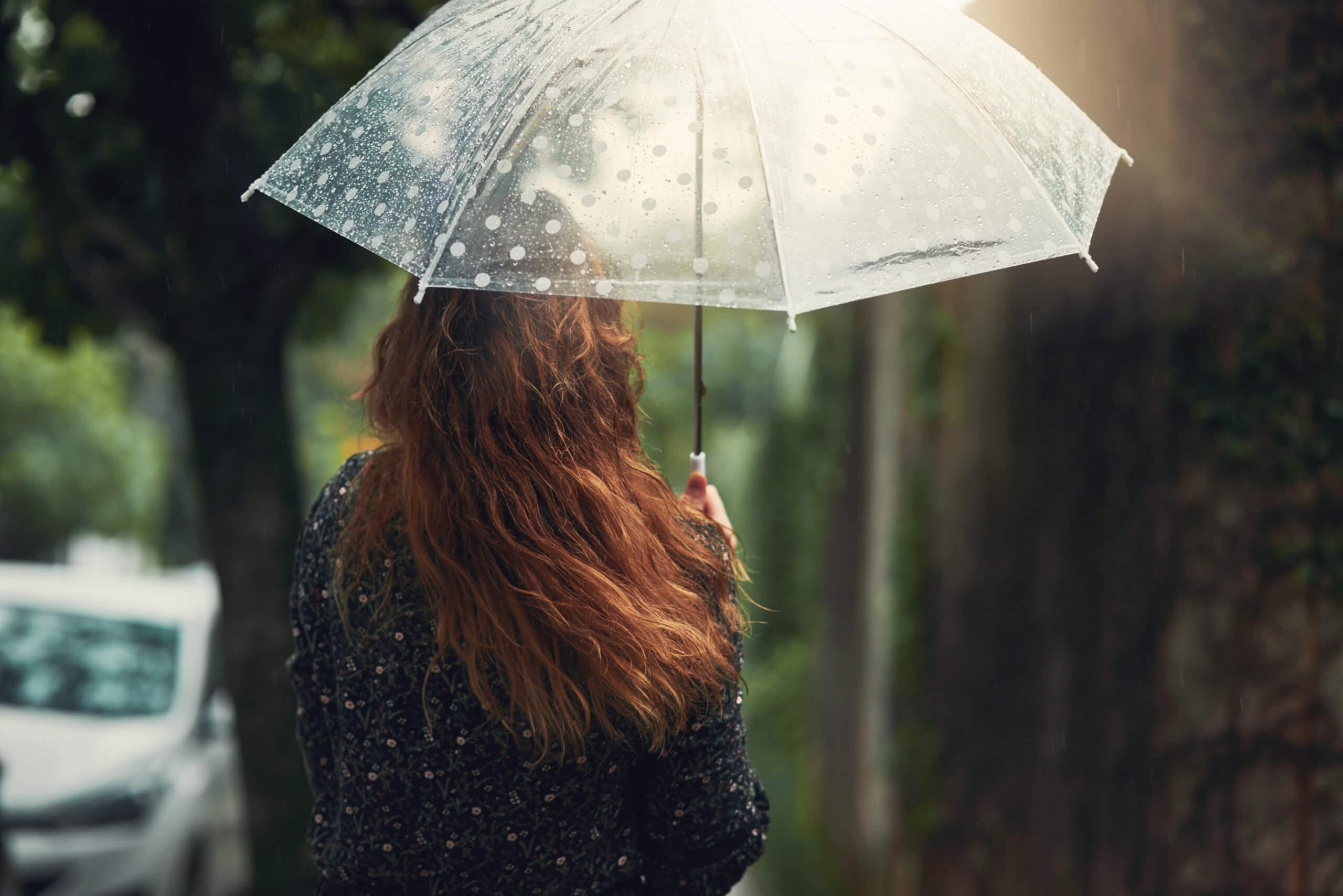 woman-under-umbrella-rain-protection
