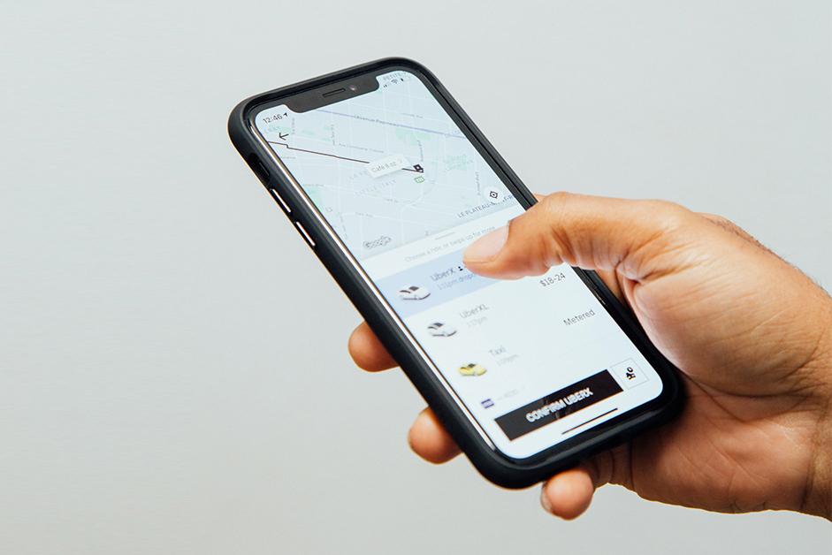 hand-holding-phone-uber-app